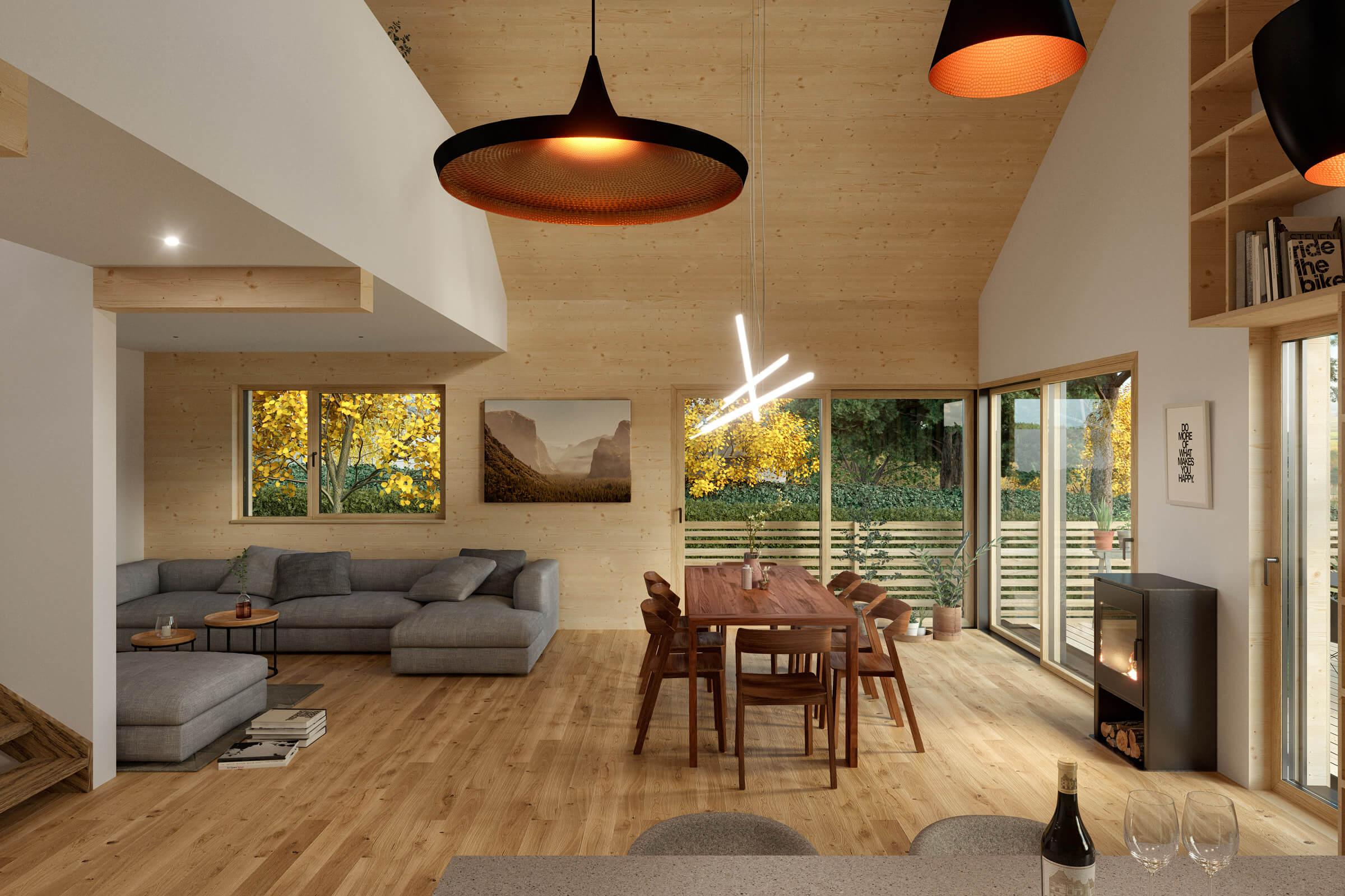 Blick von der Küche über das Wohnzimmer mit Gallerie in den grünen Garten